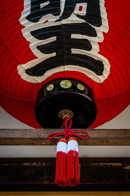 A red paper lantern hangs in Dojuin, a temple in the Tofukuji temple complex of Kyoto