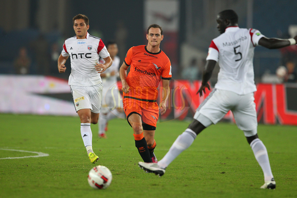 Wim Raymaekers of Delhi Dynamos FC threads the ball through during match 16 of the Hero Indian Super League between The Delhi Dynamos FC and NorthEast United FC held at the Jawaharlal Nehru Stadium, Delhi, India on the 29th October 2014.<br /> <br /> Photo by:  Ron Gaunt/ ISL/ SPORTZPICS
