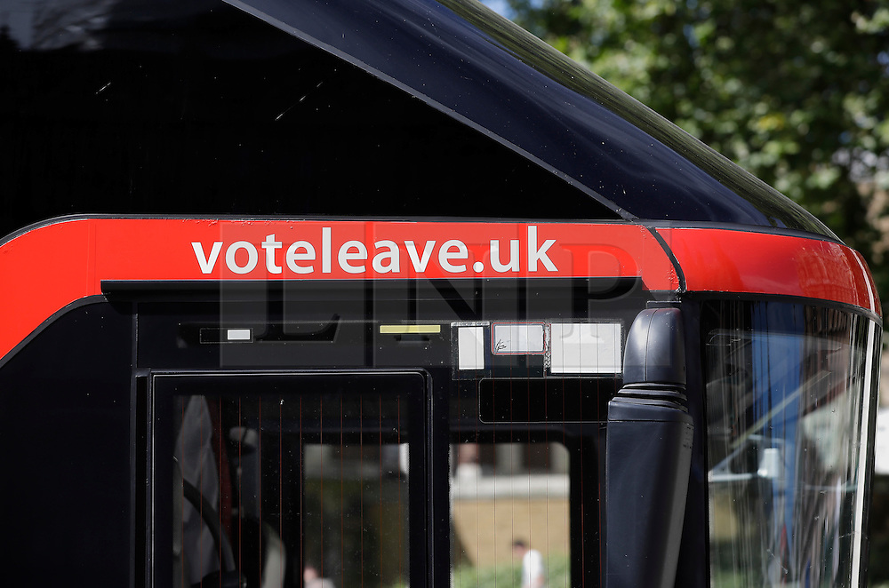 "© Licensed to London News Pictures. 18/07/2016. London, UK. The wording ""voteleave.uk still written on the side of the bus. A bus used by the Leave campaign during the EU referendum, rebranded by Greenpeace outside the Houses of Parliament in London. The ""Brexit Bus"" was previously covered in a slogan claiming that £350 million sent to the EU could be spent on the NHS.  Photo credit: Peter Macdiarmid/LNP"