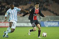 FOOTBALL - UEFA EUROPA LEAGUE 2011/2012 - GROUP STAGE - GROUP F - PARIS SAINT GERMAIN v SLOVAN BRATISLAVA - 3/11/2011 - PHOTO JEAN MARIE HERVIO / DPPI - JAVIER PASTORE (PSG) / KARIM GUEDE (BRA)