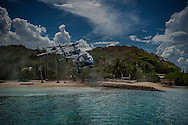 Jacques Branellec heads back to Manila in his helicopter from his pearl farm in Shark's Fin Bay.  Tay Tay, Palawan, Philippines.