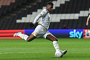 Milton Keynes Dons striker Kieran Agard (14) takes a shot at goal during the EFL Trophy match between Milton Keynes Dons and Wycombe Wanderers at stadium:mk, Milton Keynes, England on 12 November 2019.