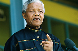 NELSON ROLIHLAHLA MANDELA (July 18, 1918 - December 5, 2013), 95, world renown civil rights activist and world leader. Mandela emerged from prison to become the first black President of South Africa in 1994. As a symbol of peacemaking, he won the 1993 Nobel Peace Prize. Joined his countries anti-apartheid movement in his 20s and then the ANC (African National Congress) in 1942. For next 20 years, he directed a campaign of peaceful, non-violent defiance against the South African government and its racist policies and for his efforts was incarcerated for 27 years. Remained strong and faithful to his cause, thru out his life, of a world of peace. Transforming the world, to make it a better place. PICTURED: 1994 - Soweto, South Africa - NELSON MANDELA at Orlando Stadium.  (Credit Image: © Greg Marinovich/ZUMA Wire/ZUMAPRESS.com)