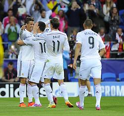 Real Madrid's Cristiano Ronaldo celebrates with team mates - Photo mandatory by-line: Joe Meredith/JMP - Mobile: 07966 386802 12/08/2014 - SPORT - FOOTBALL - Cardiff - Cardiff City Stadium - Real Madrid v Sevilla - UEFA Super Cup