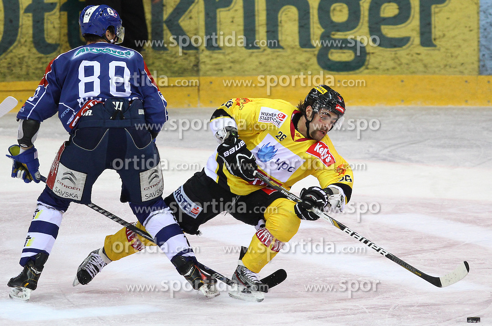 13.02.2013, Albert Schultz Eishalle, Wien, AUT, EBEL, UPC Vienna Capitals vs KHL Medvescak Zagreb, 6. Platzierungsrunde, im Bild Dario Kostovic, (KHL Medvescak Zagreb, #88) und Michael Schiechl, (UPC Vienna Capitals, #26)  // during the Erste Bank Icehockey League 6th placement Round match betweeen UPC Vienna Capitals and KHL Medvescak Zagreb at the Albert Schultz Ice Arena, Vienna, Austria on 2013/02/13. EXPA Pictures © 2013, PhotoCredit: EXPA/ Thomas Haumer