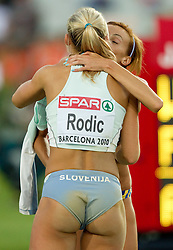 Snezana Rodic of Slovenia and Adelina Gavrila of Romania after competing during the women's triple jump final at the 2010 European Athletics Championships at the Olympic Stadium in Barcelona on July 31, 2010.(Photo by Vid Ponikvar / Sportida)