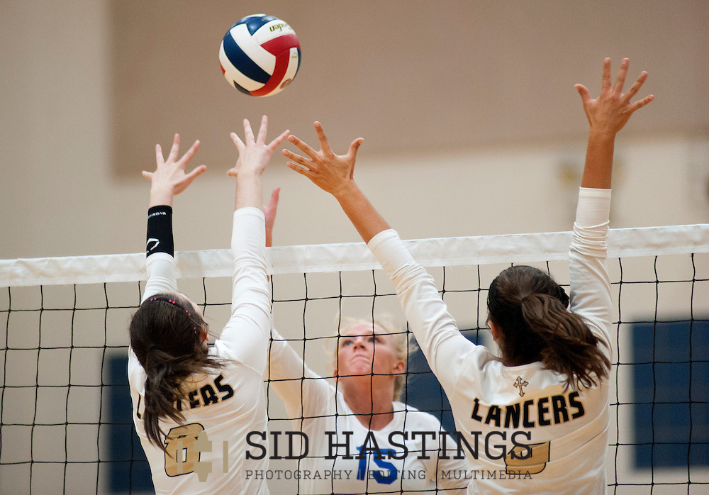 25 AUG. 2015 -- ST. CHARLES, Mo. --Duchesne High School volleyball player Natalie Schroeder (15) attempts to tip the ball over the defense of St. Pius X High School's Emma Grimshaw (8) and Jena Otec (9) at Duchesne in St. Charles, Mo. Tuesday, Aug. 25, 2015. St. Pius won, 2-0 (25-14, 25-23), to advance to 6-0. It was Duchesne's first match, dropping them to 0-1 on the year. Photo © copyright Sid Hastings.