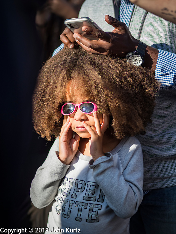 12 OCTOBER 2019 - DES MOINES, IOWA: A child listens to Senator Kamala Harris (D-CA) in Des Moines Saturday. Sen. Harris attended a neighborhood block party in Des Moines as a part of her campaign to be the Democratic nominee for the US presidency in 2020. Iowa traditionally holds the first selection of the presidential election cycle. The Iowa caucuses are Feb. 3, 2020.        PHOTO BY JACK KURTZ