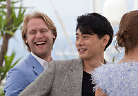 Producer Ilya Stewart and actor Teo Yoo at the Leto (Summer) film photo call at the 71st Cannes Film Festival, Thursday 10th May 2018, Cannes, France. Photo credit: Doreen Kennedy