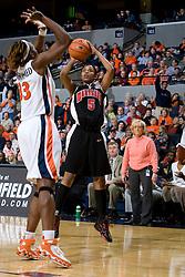 Maryland guard Marah Strickland (5) shoots over Virginia center Aisha Mohammed (33).  The Virginia Cavaliers women's basketball team faced the #4 ranked Maryland Terrapins at the John Paul Jones Arena in Charlottesville, VA on January 18, 2008.