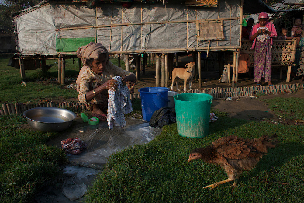 A Rohingya woman washes clothes in an IDP camp in Sittwe, Myanmar.