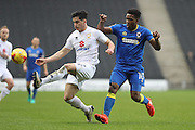 AFC Wimbledon striker Dominic Poleon (10) and Milton Keynes Dons defender George B Williams (12) during the EFL Sky Bet League 1 match between Milton Keynes Dons and AFC Wimbledon at Stadium MK, Milton Keynes, England on 10 December 2016. Photo by Stuart Butcher.