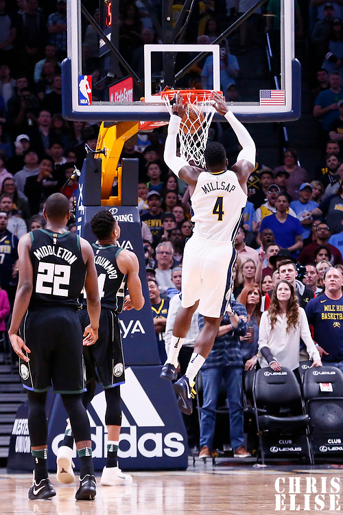 01 April 2018: Denver Nuggets forward Paul Millsap (4) dunks the ball during the Denver Nuggets 128-125 victory over the Milwaukee Bucks, at the Pepsi Center, Denver, Colorado, USA.