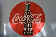 Detail of a Coca-Cola sign on a wall outside a small community shop in a village near Medinet Habu on the West Bank of Luxor, Nile Valley, Egypt.