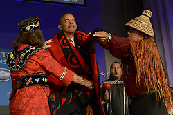 September 26, 2016 - Washington, DC, United States of America - U.S. President Barack Obama has a ceremonial blanket arranged on him by Mohegan Chief Lynn Malerba, left, and Brian Cladoosby, President of National Congress of American Indians, during the White House Tribal Nations Conference at the Mellon Auditorium September 26, 2016 in Washington, DC. (Credit Image: © Interior Department/Planet Pix via ZUMA Wire)
