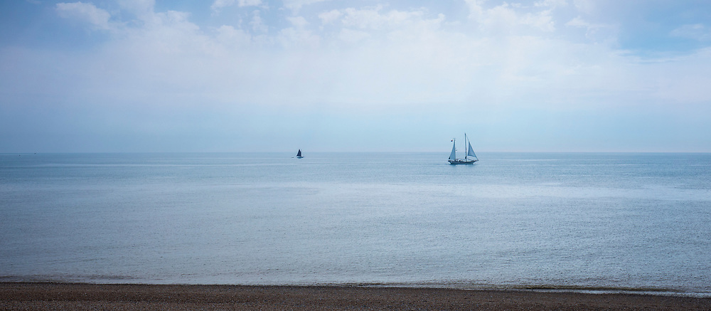 Yachts at sea in the English Channel off the coast of Dungeness in Kent, UK