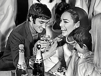 Manchester United soccer star, George Best, shares a glass of bubbly with fans at the opening of the Mint Imperial Discotheque in Belfast, N Ireland. 196801000031a, 31/68.<br />