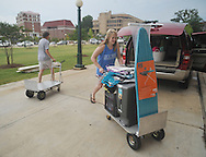 Annelise Albert moves items into a dorm at the University of Mississippi in Oxford, Miss. on Wednesday, August 17, 2011. Students have begun moving in for the fall semester of classes, which begin Monday, August 22, 2011. (AP Photo/Oxford Eagle, Bruce Newman)