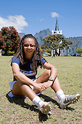 Hope Powell, coach of the England women's national football team ,  sits in football attire in South Africa with the charity, Coaching for Hope. The charity is an innovative programme, which uses football to create better futures for young people in West and Southern Africa