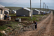 A young IDP (internally displaced persons) boy rides his bicycle at a camp outside Tblisi, Georgia. The camp was set up after the war with Russia in August 2008. Georgia, a former Soviet country, has been engaged in border conflict with its giant neighbour since the breakup of the Soviet Union in the early 1990s.