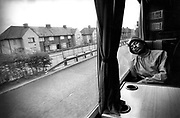 US rapper Big Daddy Kane asleep on a coach on the road to Southampton during a British tour, UK, 1988