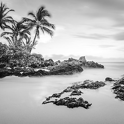 Secret Cove Beach Maui Hawaii black and white photo.  Also known as Wedding Beach, Makena Cove, and Pa'ako Cove, Secret Cove Beach is a popular beach in Wailea Kihei Hawaii. In the background is Ahihi Bay and the Pacific Ocean. Copyright ⓒ 2019 Paul Velgos with All Rights Reserved.