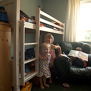 The beds of the three youngest children have been moved into the living room to create more space to their older sibling.