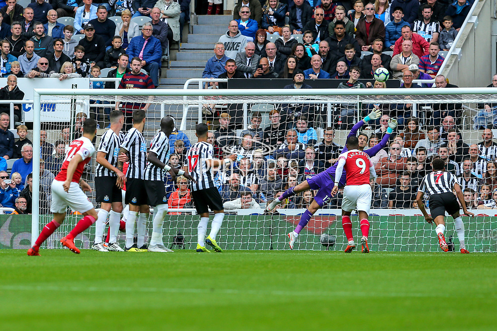 Granit Xhaka (#34) scores Arsenal's first goal (0-1) with a free kick which beats the diving Martin Dubravka (#12) of Newcastle Unitedof Arsenal during the Premier League match between Newcastle United and Arsenal at St. James's Park, Newcastle, England on 15 September 2018.