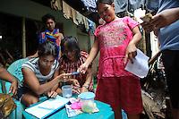 Women running a lottery-style microfinance scheme, Tallo, Makassar, Sulawesi, Indonesia.