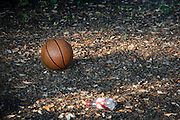 A basketball rests on the locked playground at the Prime Prep Academy campus in Fort Worth, Texas on August 4, 2014. (Cooper Neill for The New York Times)