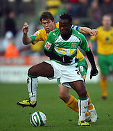 Yeovil - Saturday December 12th, 2009:  Norwich's Grant Holt and Yeovil's Jean-Paul Kalala in action during the Coca Cola League One match at Huish Park, Yeovil. (Pic by Paul Chesterton/Focus Images)