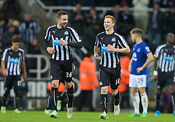 NEWCASTLE-UPON-TYNE, ENGLAND - Sunday, December 28, 2014: Newcastle United's Jack Colback shares a joke with team-mate Paul Dummett after scoring the third goal against Everton during the Premier League match at St. James' Park. (Pic by David Rawcliffe/Propaganda)