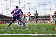 Barnsley are denied as Luke McCullough of Doncaster Rovers clears the ball during the Sky Bet League 1 match between Doncaster Rovers and Barnsley at the Keepmoat Stadium, Doncaster, England on 3 October 2015. Photo by Ian Lyall.