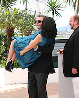 Alec Baldwin carries  Hilaria Baldwin at the 'Seduced And Abandoned' film photocall at the Cannes Film Festival  Tuesday 21 May 2013