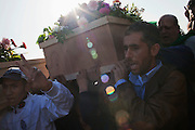 Libyans carry the coffins of the victims of the 23 march bombardment during the funeral the day after in a cemetery of Tripoli..According to Libyan authorities, at least 100 people have died in military strikes by European and US forces.