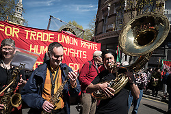 © Licensed to London News Pictures. 01/05/2016. London, UK. A tuba player at the start of the May Day rally in central London. Thousands gathered on Clerkenwell Green to mark May Day. Photo credit : Rob Pinney/LNP