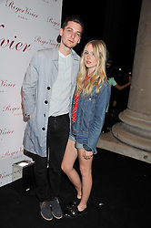 Singer DIANA VICKERS and GEORGE CRAIG at a party hosted by Ines de la Frassange and Bruno Frisoni for Roger Vivier to launch the Roger Vivier book held at The Saatchi Gallery, London on 24th April 2013.