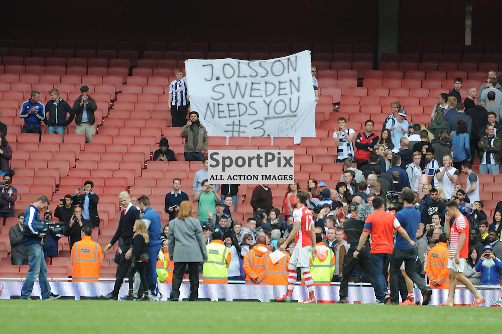 West Brom fans hold up a banner for Jonas Olsson after Arsenal v West Brom match on Sunday 24th May 2015