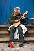 Man playing Charango, Cusco, Urubamba Province, Peru