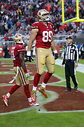 San Francisco 49ers tight end Vance McDonald (89) leaps in the air and yells out as he celebrates after catching an 18 yard touchdown pass that cuts the New England Patriots second quarter lead to 13-10 during the 2016 NFL week 11 regular season football game against the New England Patriots on Sunday, Nov. 20, 2016 in Santa Clara, Calif. The Patriots won the game 30-17. (©Paul Anthony Spinelli)