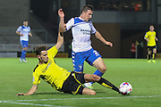 Burton Albion defender Tom Flanagan (2) challenges Bury FC defender Craig Jones (2) on the edge of the box during the EFL Cup match between Burton Albion and Bury at the Pirelli Stadium, Burton upon Trent, England on 10 August 2016. Photo by Aaron  Lupton.