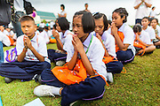 """23 APRIL 2013 - BANGKOK, THAILAND:  Thai students pray during the opening ceremony to mark Bangkok as the World Book Capital City 2013. UNESCO awarded Bangkok the title. Bangkok is the 13th city to assume the title of """"World Book Capital"""", taking over from Yerevan, Armenia. Bangkok Governor Suhumbhand Paribatra announced plans that the Bangkok Metropolitan Administration (BMA) intends to encourage reading among Thais. The BMA runs 37 public libraries in the city and has modernised 14 of them. It plans to build 10 more public libraries every year. Port Harcourt, Nigeria will be the next World Book Capital in 2014. .PHOTO BY JACK KURTZ"""