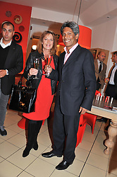 DES GUNEWARDENA and his wife LIZ at an exhibition at The Conran Shop entitled Red to celebrate 25 years of The Conran Shop at the Michelin Building, 81 Fulham Road, London on 19th September 2012.