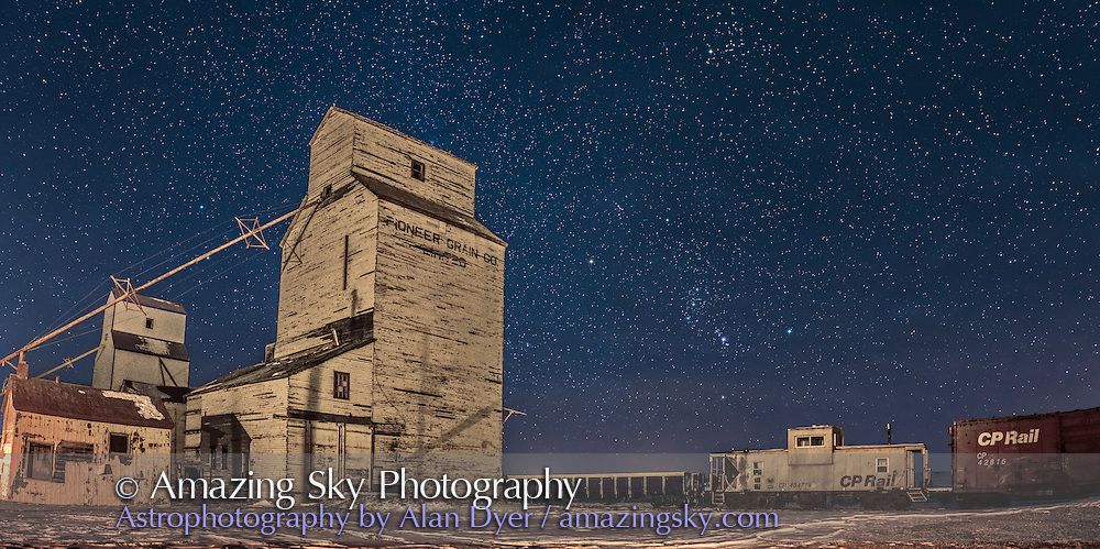 Orion and the winter stars rising behind the old Pioneer Grain Co elevators at Mossleigh, Alberta, on December 28, 2016, in a two-panel panorama. <br /> <br /> A &ldquo;vintage filter&rdquo; from the Luminar plug-in was applied to the ground to add more of a sepia tone, though the ground was lit by yellow sodium vapour yard lights. <br /> <br /> Taken with 24mm lens and Nikon D750 for 13 seconds each, at f/2.8 and ISO 1000. Star diffraction spikes added with Astronomy Tools action.