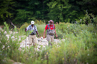 USP alum Lou Sarkas (right) and volunteer Joe Hopkins approaching the Deerfield River to fly fish.
