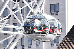 © Licensed to London News Pictures. 10/10/2016. London, UK.   THE DUKE and DUCHESS OF CAMBRIDGE and PRINCE HARRY on The London Eye during a visit to celebrate World Mental Health Day. The royals also attened a Heads Together event at County Hall where they met  people who have received help from mental health charities. Photo credit: Ben Cawthra/LNP