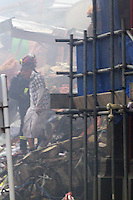 Topi Mery emerges from the wreckage of the CTV building in Christchurch City Centre after five hours trapped in the rubble after a Powerful earth quack ripped through Christchurch, New Zealand on Tuesday lunch time killing at least 65 people as it brought down buildings, buckled roads and damaged churches and the Cities Cathedral. Photo Tim Clayton