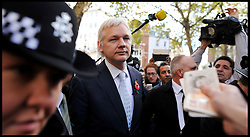 WikiLeaks founder Julian Assange receives £200 from a member of the public as he leaves The High Court, London. Mr Assange has failed in his bid to stop his extradition to Sweden to face sexual assault allegations, Wednesday November 2, 2011 Photo By Andrew Parsons/ i-Images.
