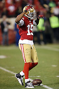 San Francisco 49ers wide receiver Michael Crabtree (15) raises his arm in celebration after a third quarter pass interference penalty gives the Niners a first down at the Atlanta Falcons 20 yard line during the NFL week 16 football game against the Atlanta Falcons on Monday, Dec. 23, 2013 in San Francisco. The 49ers won the game 34-24. ©Paul Anthony Spinelli