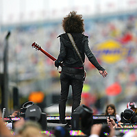 Lenny Kravitz performs prior the Daytona NASCAR race.